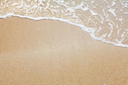 Sand-und Wave-Hintergrund Standard-Bild