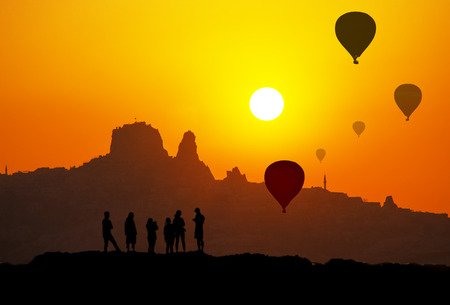 Sunset and silhouette of Uchisar Castle in Cappadocia Turkey