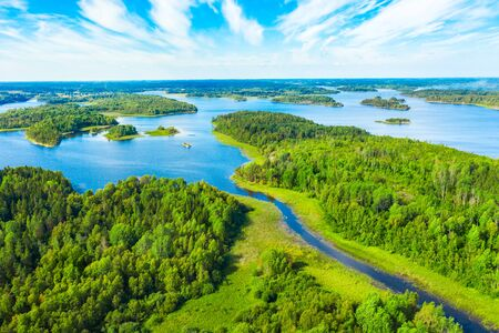 Aerial view of green islands and blue lake Stock Photo