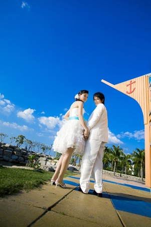 Bride and groom on the street and sky