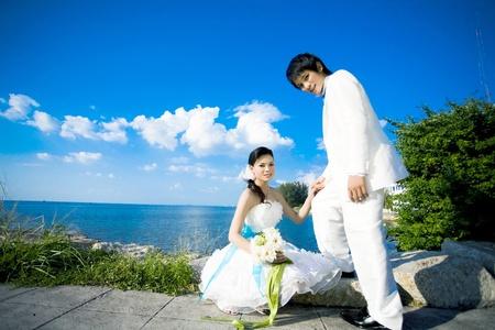 A married couple on a sky beautiful and the beach. photo