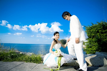 A married couple on a sky beautiful and the beach. Stock Photo