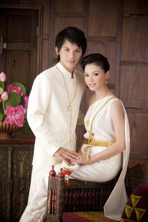 Studio shot of wedding couple on the background
