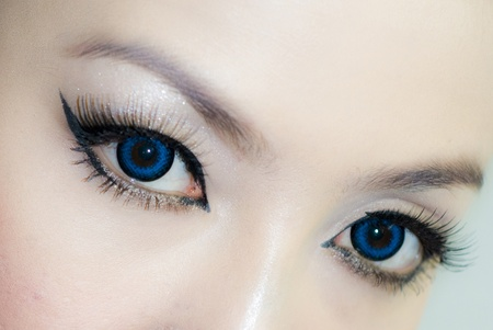 the attractive woman blue color eyes closeup 