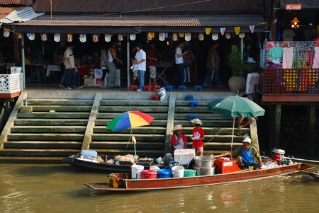amphawa: view on amphawa floating market early in the morning with boat sailing in Thailand on 6 February 2010. Editorial