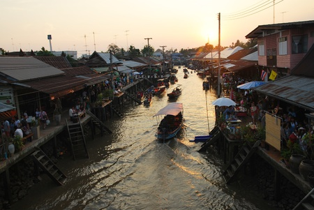 view on amphawa floating market early in the morning with boat sailing in Thailand on 6 February 2010. Editorial