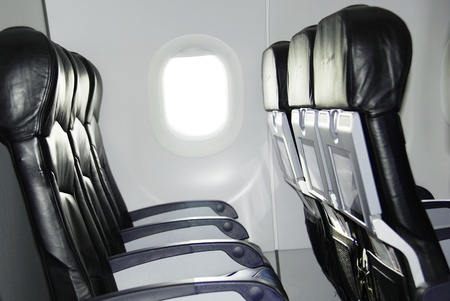 plane table: Avi�n del asiento y la ventana en el interior de un avi�n