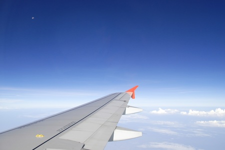 airbus: Airplane wing in the blue sky with white clouds
