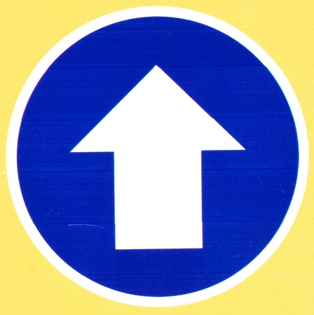 Blue Road Sign With Arrow on color photo