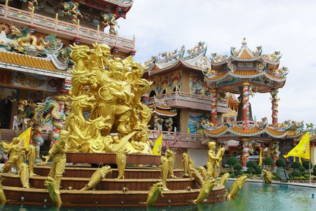 Goddess Naja beating the dragon and china temple Chonburi Thailand