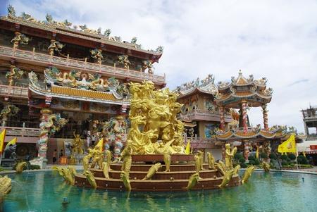 Goddess Naja beating the dragon and china temple Chonburi Thailand on 17 November 2011