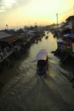 view on amphawa floating market early in the morning with boat sailing in Thailand on 6 February 2010. photo