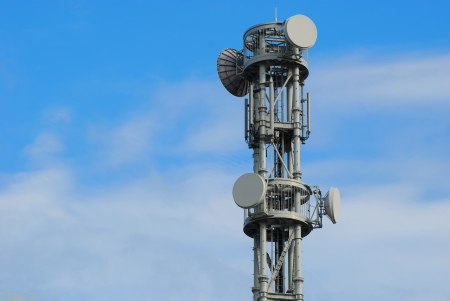 The telecommunications tower with many satellite dish photo