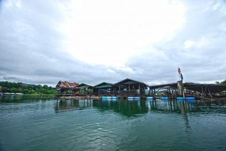 The raft house on the river in Sangkhlaburi Stock Photo - 14145449