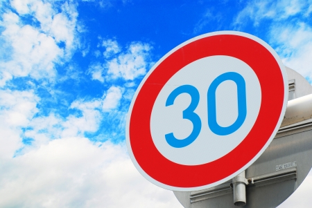 Road sign speed limit 30 on the sky photo