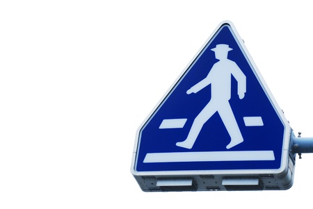 The old traffic sign pedestrian crossing on white background photo