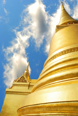 Thailand grand palace Gold pagoda with cloud blue sky photo