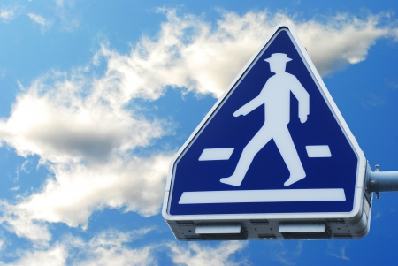 The old traffic sign pedestrian crossing on sky photo