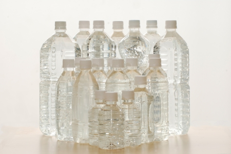 The group plastic bottles of water on background photo