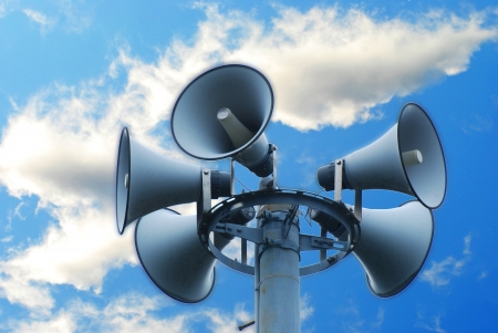 The many loudspeakers against cloudy blue sky photo