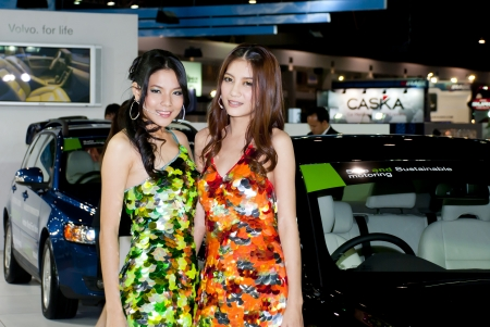 BANGKOK, THAILAND - DECEMBER 4  Unidentified women presenter at the booth in THE THAILAND INTERNATIONAL MOTOR EXPO 2009 on December 4, 2009 in Bangkok, Thailand