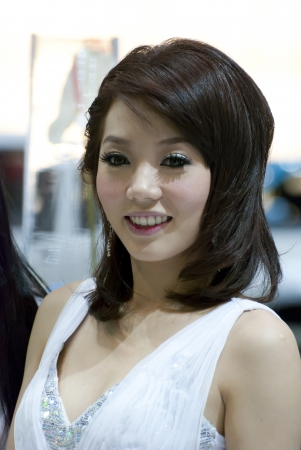 BANGKOK, THAILAND - DECEMBER 4  Unidentified female presenter at the booth in THE THAILAND INTERNATIONAL MOTOR EXPO 2009 on December 4, 2009 in Bangkok, Thailand