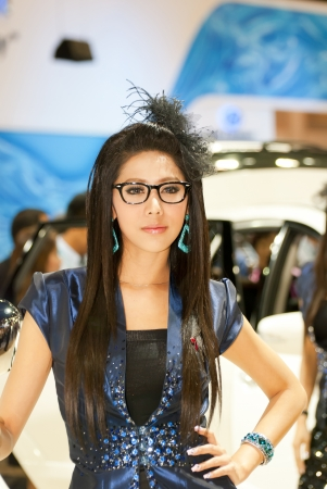 BANGKOK, THAILAND - DECEMBER 4: Unidentified female presenter at the booth in THE THAILAND INTERNATIONAL MOTOR EXPO 2009 on December 4, 2009 in Bangkok, Thailand. Editorial