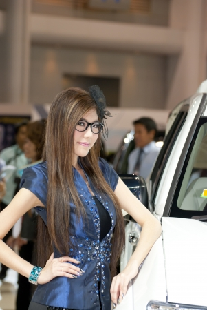 BANGKOK, THAILAND - DECEMBER 4: Unidentified female presenter at the booth in THE THAILAND INTERNATIONAL MOTOR EXPO 2009 on December 4, 2009 in Bangkok, Thailand.