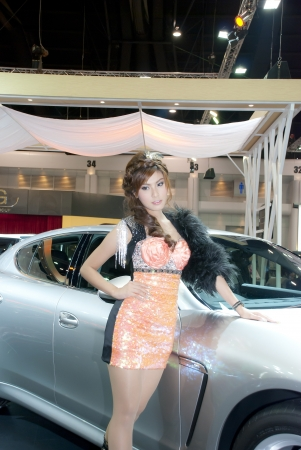 BANGKOK, THAILAND - DECEMBER 4: Unidentified female presenter at the booth in THE THAILAND INTERNATIONAL MOTOR EXPO 2009 on December 4, 2009 in Bangkok, Thailand. Stock Photo - 17044734