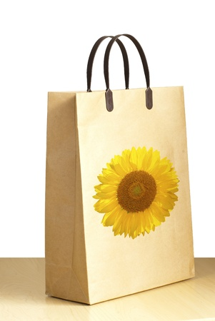 Sunflower paper bag for packing on the white background