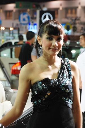 BANGKOK, THAILAND – Mar 29: Pretty Girl at the booth in THE THAILAND INTERNATIONAL MOTOR EXPO 2009 on Mar 29, 2009 in Bangkok, Thailand.