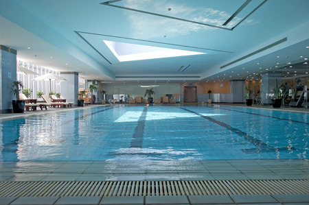 pool side: Indoor swimming pool and leisure chairs Editorial