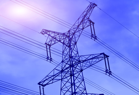 Pylon and transmission power line in sunset photo
