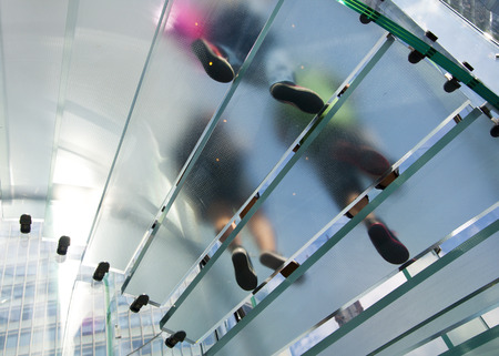 Modern Glass Staircase Silhouette of walking People in shanghai china  photo