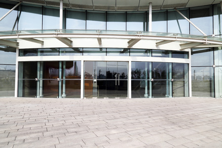 front door: Facade of modern Business Center with glass doors Editorial