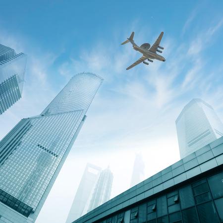 flew: The plane flew over modern architecture
