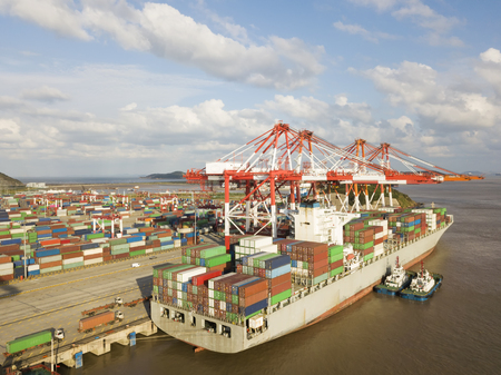 Logistics and transportation of Container Cargo ship and Cargo plane with working crane bridge in shipyard, logistic import export and transport industry background