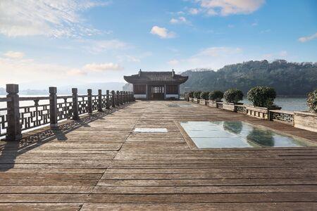 wooden trestle on a lake Фото со стока
