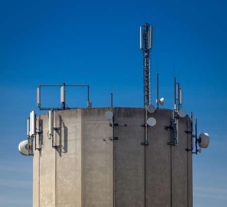 electromagnetic radiation: Radio antennas on a concrete tower