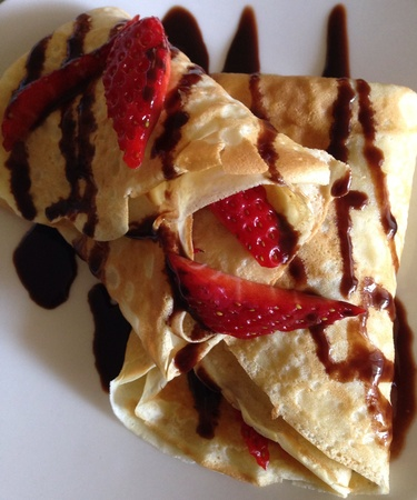 Crepes with strawberry and chocolate.