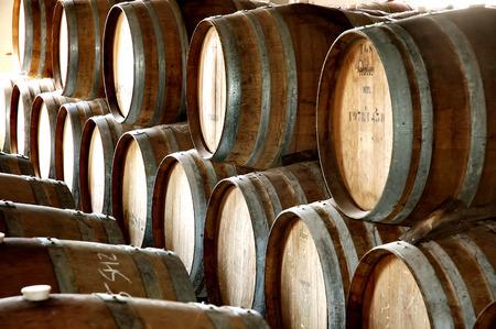 vats: Wine barrels stack in storage rows