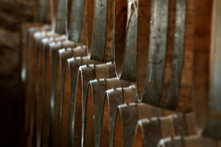 Wine barrels stack in rows Stock Photo