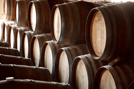 Wine barrels stacked in rows