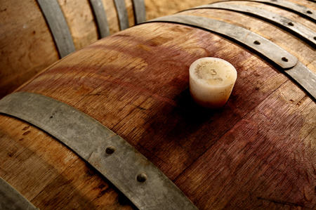 maturing: Winery cellar featuring wine barrels in storage Stock Photo