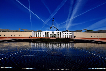 senate: Parliament House Canberra with Jet Trails in Sky Stock Photo