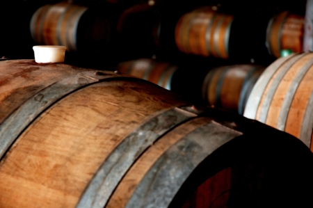 Photo of historical wine barrels in winery cellar