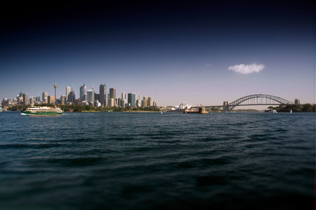 polarised: Sydney CBD from Sydney Harbour featuring the city, circular quays, the rocks, ferry, waterfront skyline and Harbour Bridge. Modern and heavily polarised.