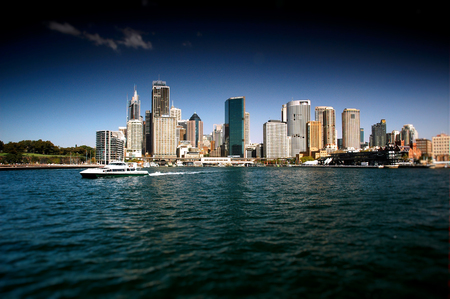 polarised: Stock Photo of Sydney CBD from Sydney Harbour featuring the city, circular quay, the rocks, ferry, waterfront skyline. Modern and heavily polarised. Stock Photo