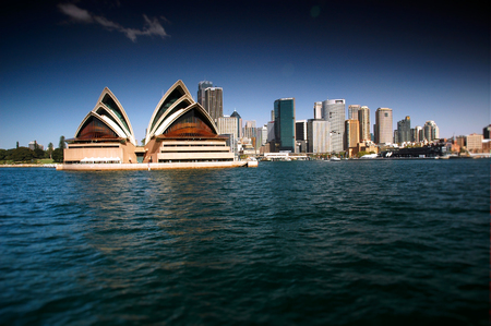 polarised: Stock Photo of Opera House and Sydney CBD from Sydney Harbour featuring the city, circular quays, the rocks, ferry, waterfront skyline. Modern and heavily polarised.
