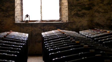 Photo of historical wine barrels in winery cellar featuring rows of oak barrels after vintage.  Areas include barossa valley, clare valley, Coonawarra, Hunter Valley, McLaren Vale Banco de Imagens